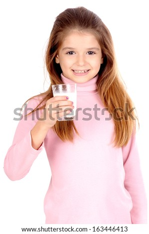 little girl with glass of milk