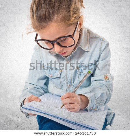 Little girl with glasses learning
