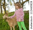 little girl with goat - stock photo