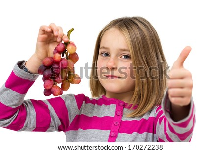 little girl with grapes isolated on white - stock photo