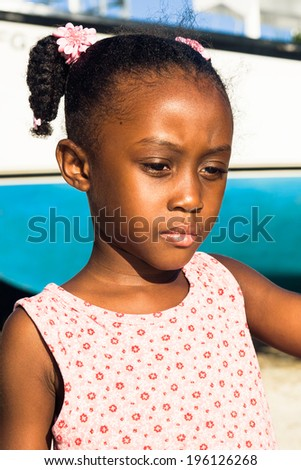 little girl with great focus and a background boat - stock photo