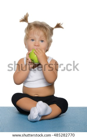 little girl with green apple on white background
