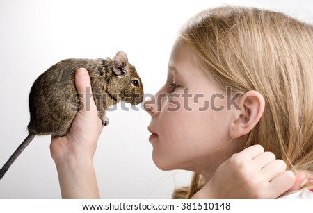 little girl with hamster profile side view portrait isolated on white - stock photo