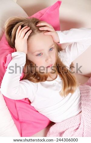 Little girl with headache - stock photo