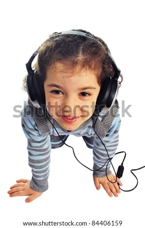 Little girl with headphones on white