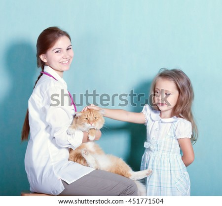 little girl with her cat at the vet  - stock photo