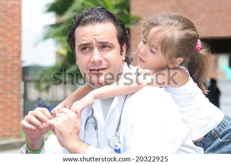 Little girl with her doctor - stock photo