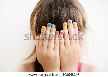 Little girl with her hands covering her eyes, see no evil - stock photo