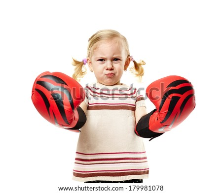 Little girl with huge red boxing gloves isolated on white background - stock photo