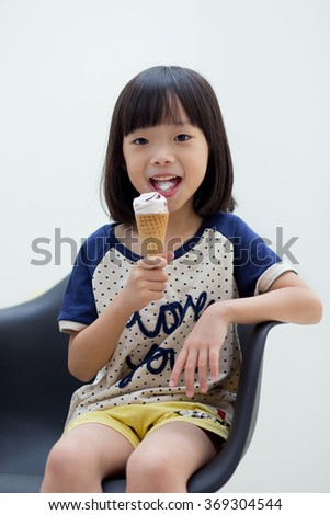 Little girl with ice cream happily - isolated - stock photo