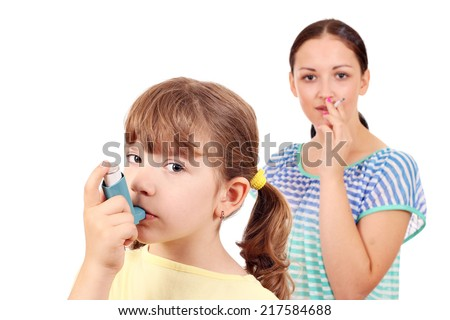 little girl with inhaler and girl smoking cigarette  - stock photo