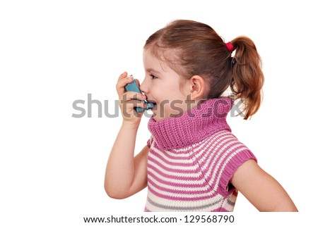 little girl with inhaler on white - stock photo