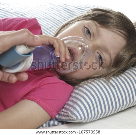 little girl with inhaler - respiratory problems for asthma - stock photo
