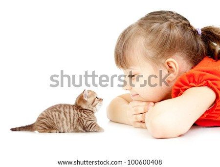Little girl with kitten face to face lying on floor together - stock photo