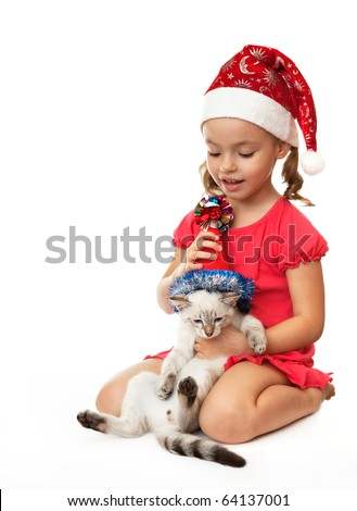 Little girl with kitten in Christmas hats. On the eastern calendar 2011 - the year the cat. - stock photo