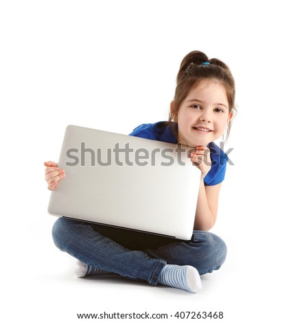 Little girl with laptop isolated on white - stock photo
