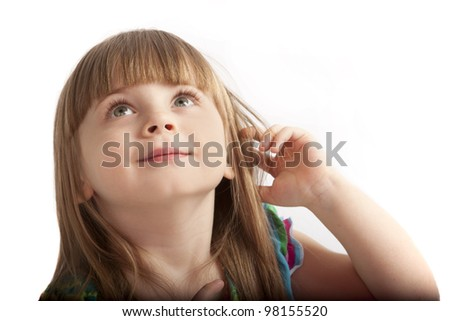 little girl with large gray eyes looking up - stock photo