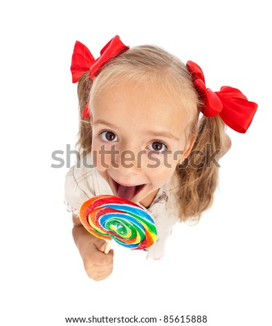 Little girl with large lollipop candy - top view, isolated - stock photo