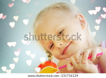 little girl with  lollipop  - stock photo