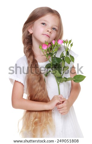 little girl with long blonde hair healthy holding a bouquet of delicate pink roses - stock photo