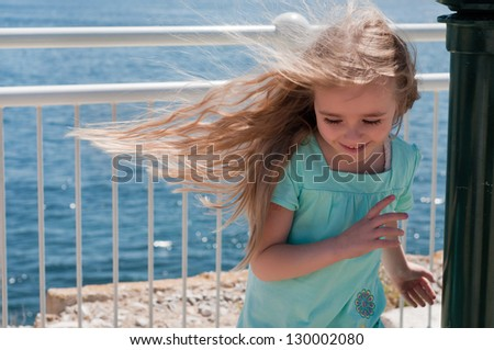 Little girl with long hair - stock photo