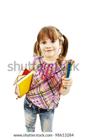 Little girl with lots of colored pencils and books. Isolated on white background - stock photo
