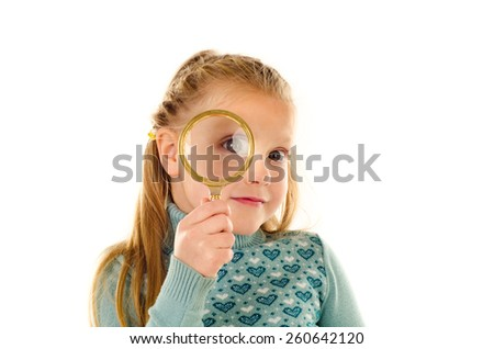 little girl with magnifier isolated on a white background - stock photo