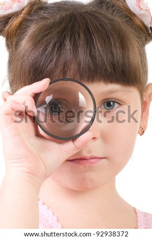 Little girl with magnifying glass isolated on white