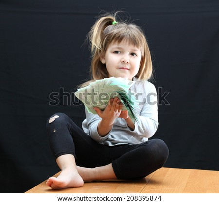 little girl with money euro - stock photo
