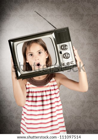 little girl with old retro television on her head - stock photo