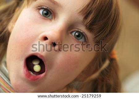Little girl with opened mouth.