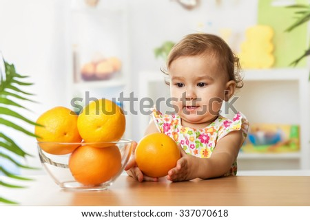 Little girl with oranges