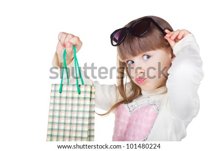 Little girl with package isolated on white background. - stock photo