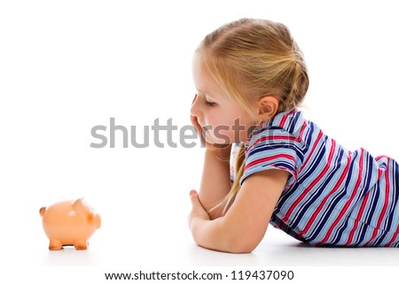 Little girl with piggy bank. Studio shot. - stock photo