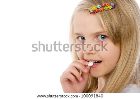little girl with pills in her hand. isolated on white background - stock photo