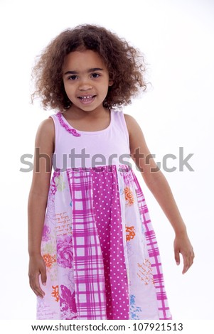 Little girl with pink dress looking happy and content