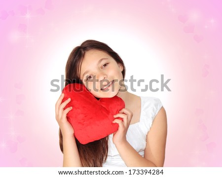 Little girl with plush heart