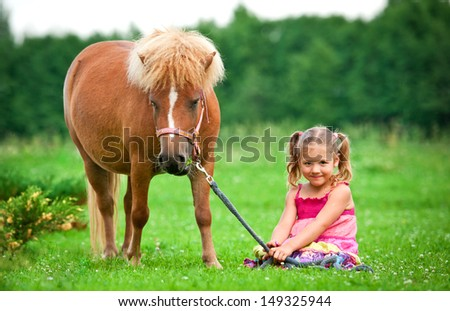 Little girl with pony - stock photo