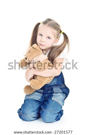 little girl with ponytails hugging her toy bear