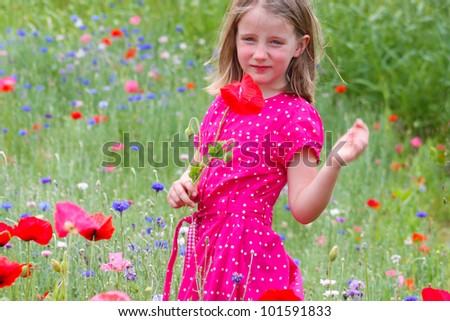 Little girl with poppies