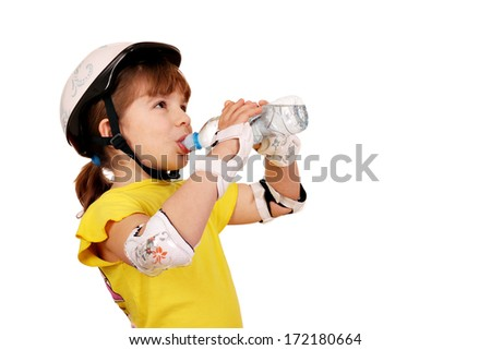 little girl with protective gear drink water  - stock photo