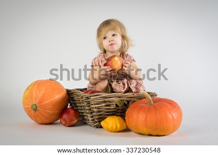 little girl with pumpkins