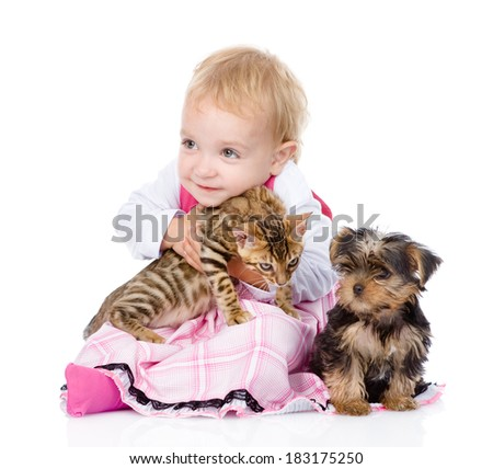 little girl with puppy hugging a kitten. isolated on white background