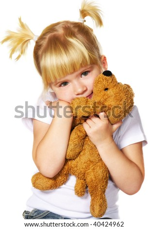 little girl with puppy toy - stock photo