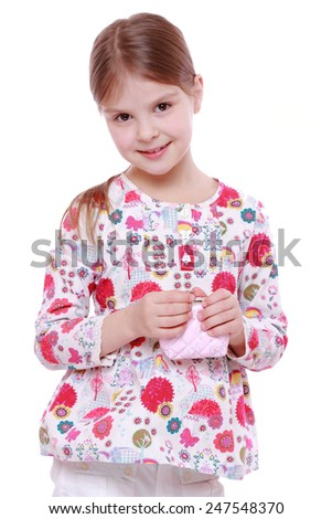 little girl with purse  - stock photo