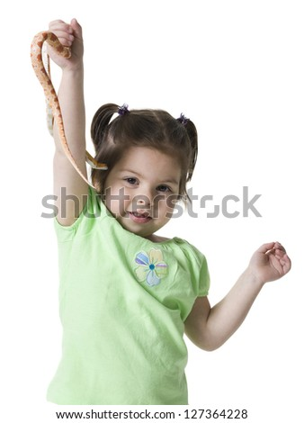 Little girl with realistic snake toy in her raised arm