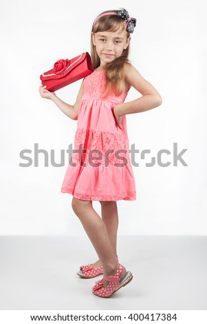 Little girl with red bag as an adult - stock photo
