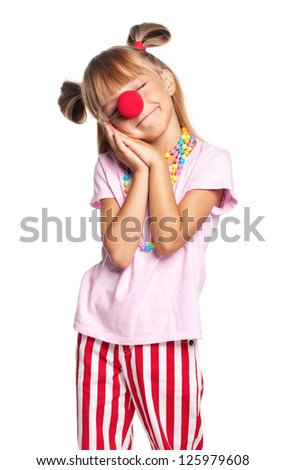 Little girl with red clown nose jokes to pretend to be sleeping, isolated on white background - stock photo