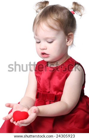 little girl with red heart - stock photo