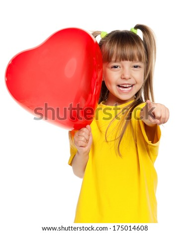 Little girl with red heart balloon over white background - stock photo